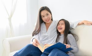 Child and mother reading a book